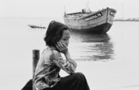 THE BOAT PEOPLE OF VIETNAM - A young Vietnamese refugee resting at the Pulan Bidong refugee camp in Malaysia.